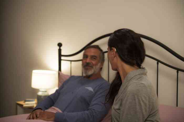 Couple in the bedroom with woman with Behind-The-Ear Hearing Aid