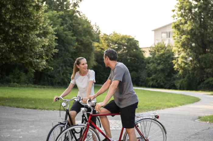 Young couple talking on their bikes