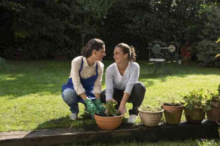 A Grandma and her Granddaughter gardening together