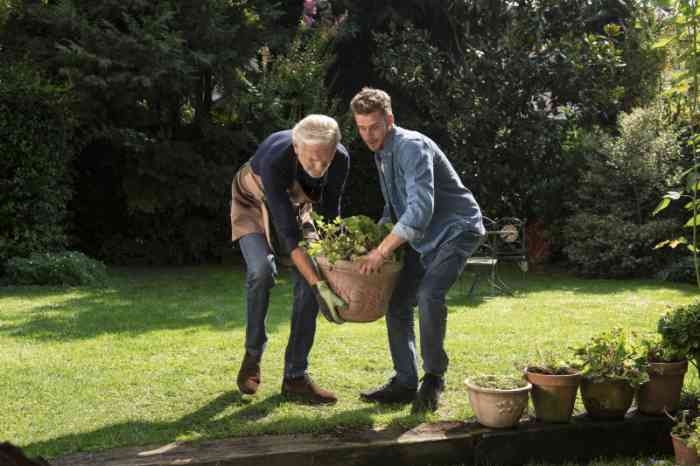 A Grandpa and his Grandson gardening together