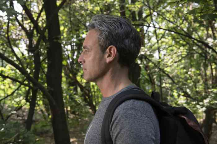 Profile of a man with a backpack in the woods