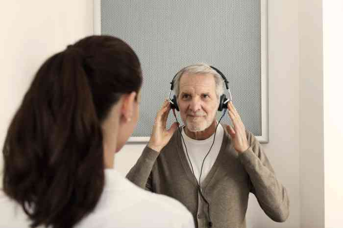 A man is attending a hearing test with an Amplifon audiologist