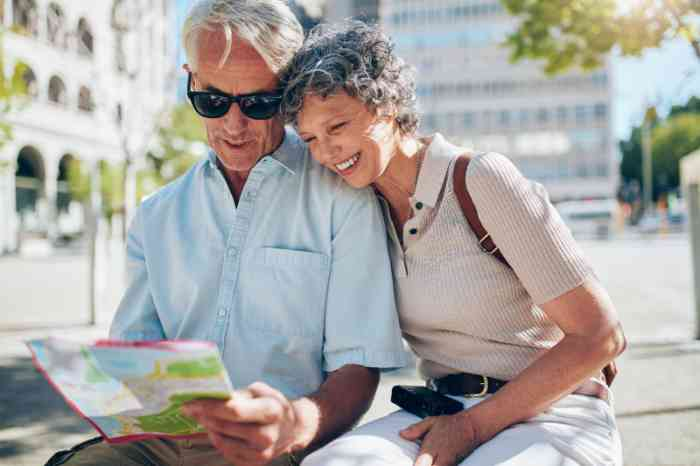A senior couple of tourist looking at a map