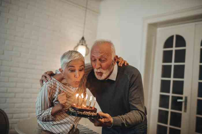 A senior couple celebrating birthday with a cake