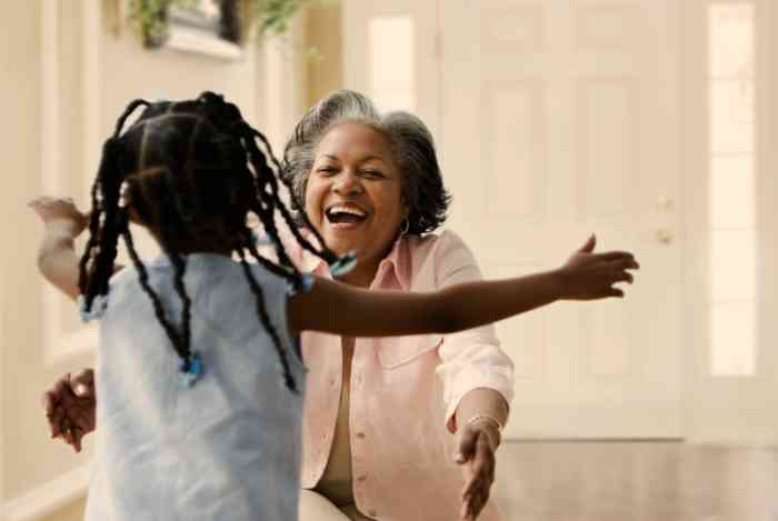 A Granddaughter running to hug her Grandma