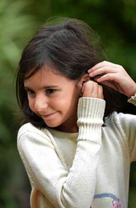 Little girl wearing Hearing Aids for Kids