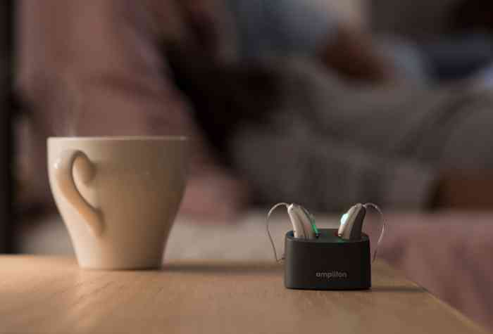 Rechargeable hearing aids in their charger during the night