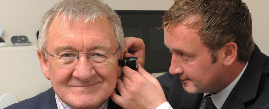 Dr Chris Steele wears hearing aids